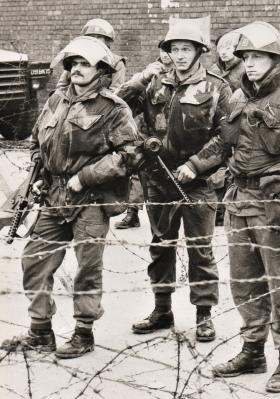 Pte Cutler (Left) and Cpl Greenwood observe a riot. Butler Street, 2nd February 1971.