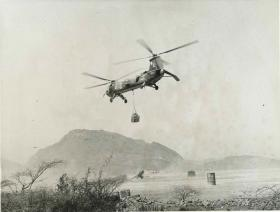 RAF Belvedere Helicopter winches supplies from a wadi. Radfan.