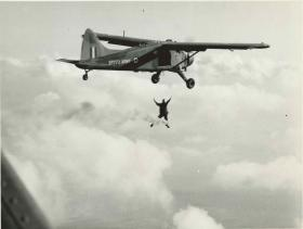 An Army free fall parachutist dropping from a BEAVER light liaison aircraft. Date unknown.