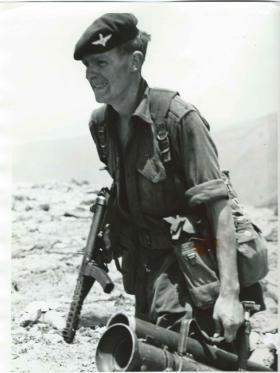 Member of 3 PARA carries weapons. Radfan.