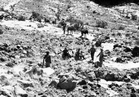 Soldiers climb up to base camp at Yo Yo in the Jebel with the NFR