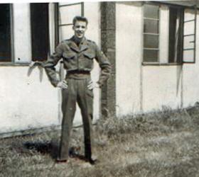 Unknown soldier outside PCAU Living Quarters. 1955.