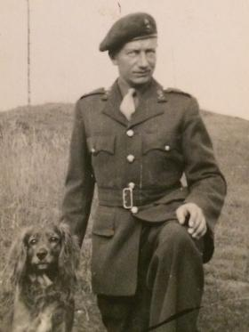 Cyril (Dick) Palmer in uniform with spaniel, 1940s.