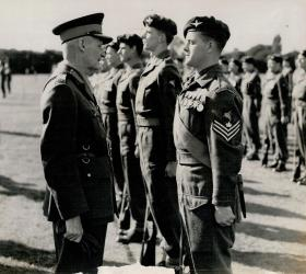 Sgt Jim Armstrong talks to Field Marshall Montgomery. Date unknown.