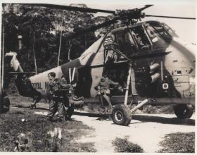 2/Lt Johnson in front of a Wessex helicopter.