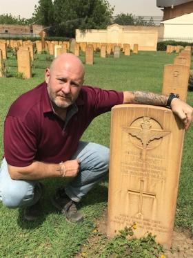 Richard Stacey (Ex 3 para) with Pte Gregg's headstone. Khartoum War Cemetery.