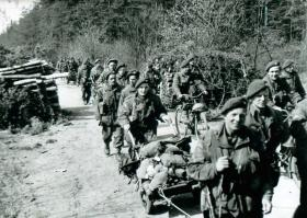 9th Parachute Battalion file past carrying equipment, Germany, March 1945