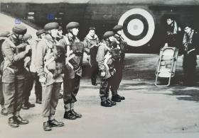 Men of the 1st Parachute Battalion parading in 'stick' order next to a Whitley at R.A.F. Ringway. Late 1941/early 1942.