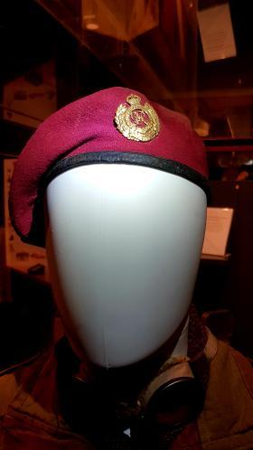 Beret and cap badge of Sgt JW Denning