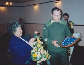 Sid Dewey's wife Mary, receiving shield