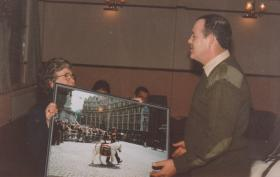 Mrs Dewey presents photograph of Sgt Pegasus III during the PARA 90 Celebration Parade in 1990