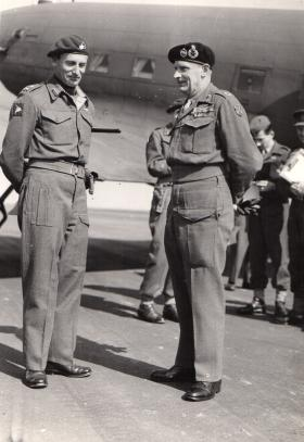 Eric Bols and Monty next to a Dakota aircraft