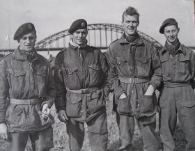 4 Escapers of 1 Para Sqn RE standing in front of Nijmegen Road Bridge