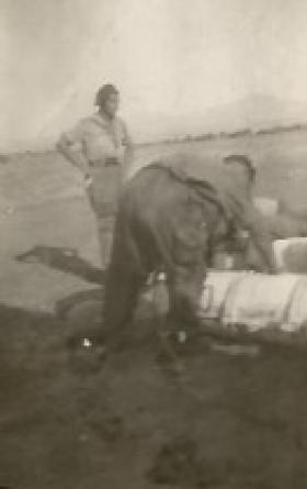 Cpl JC Driver loading containers for OP DRAGOON 14th AUG '44