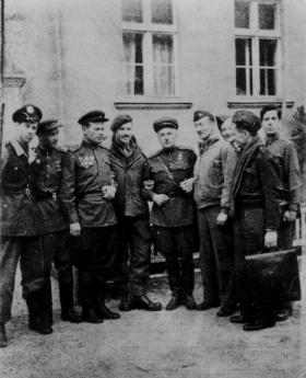 British and American POW's of Stalag Luft 1, with their Russian liberators. April 1945.
