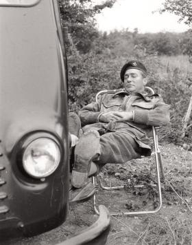 "Richard Todd relaxing on the set of ""The Longest Day"", Normandy, 1959."