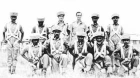 John B Sanderson with recruits wearing 'sorbo' helmets, India