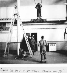 Major John Sanderson attaches indoor  parachute harness. Rawalpindi 1944
