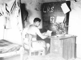 John B Sanderson at his desk, India