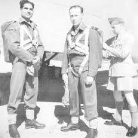 Jock Grimmond having parachute fitted. Mohn Kahn watching. Rawalpindi 1944