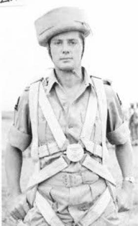 John B Sanderson wearing parachute and 'sorbo' helmet, India