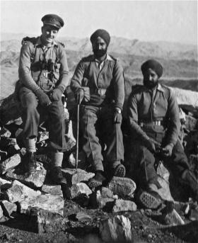 John B Sanderson on mountain O.P with two Sikh colleagues