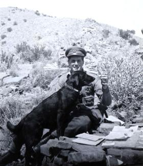 John B Sanderson with regimental mascot Susan, 1945