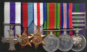 Major J A N Sim medal set
