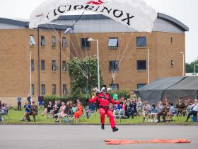 A member of The Red Devils lands at the Colours Parade, 13 July 2021