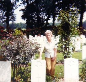 Pte Cartmans sister at his grave, 1980s.