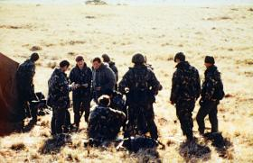 Battalion HQ Officers, Lt Col 'H' Jones in the centre, Sussex Mountains area, May 1982.
