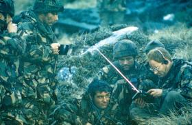 Members of Support Coy HQ, 2 PARA, listening to the BBC World News, Sussex Mountain c22– 26 May 1982.