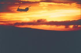 A Chinook silhouetted in the evening sunset, Falklands 1982.