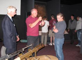 Museum volunteer Bob Hilton explains the workings of a PIAT to a visitor fom 2 PARA, Oct 2011