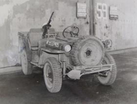 Airborne Reconnaissance Jeep showing front mounted spare wheel, tools and Vickers K Machine Gun, c. 1944