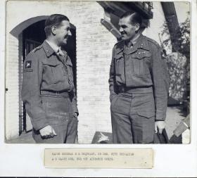 Brigadier A.G. Walch talks with Major General Urquhart.