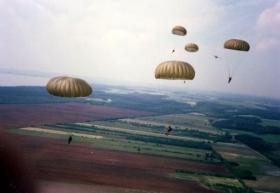 Parachutists of 10 PARA perform a clean fatigue jump from a Luftwaffe Transall C-160, Germany, Summer 1989.