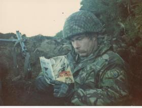 Steve Thayer in a defensive position, Fitzroy, Falklands, 1982