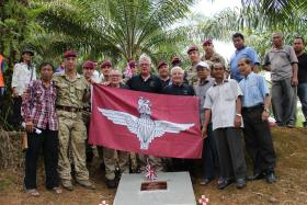 Members of 2 PARA past and present with Maj Gen Bashall CBE and Wo2 Phil Stout with villagers of Plaman Mapu, 2015.
