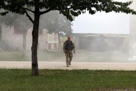 Capt Dunn, OC of C Coy 4 PARA on Exercise Black Panther, Copehill Down OBUA Village, Salisbury Plain, July 2015.