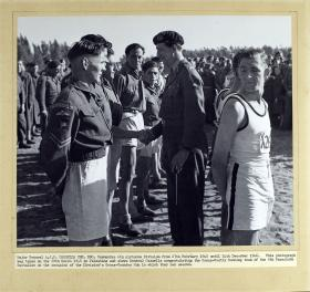 Major General AJH Cassels congratulates the Cross Country Running team of the 8th Parachute Battalion, 1946.