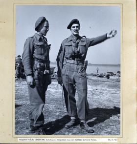 Photograph of Brigadier W.S.F Hickie talking to an Officer