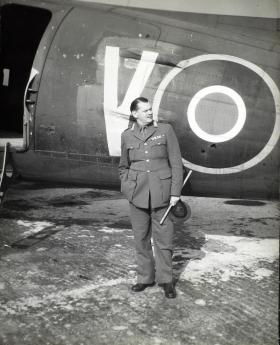 Photograph of Richard Gale standing in front of plane