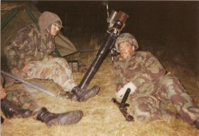 Pte Keith Carver and Pte Lee Crichton of A Coy, 4 PARA Mortars on night shoot, 1980s