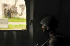 A paratrooper taking part in Exercise Red Falcon at Fort Bragg, North Carolina, August 2014
