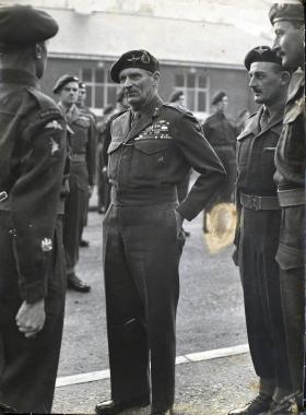Photograph of Field Marshal Bernard Law Montgomery inspecting the troops