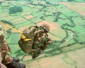 A Member of 144 Parachuting from a Black Hawk, Bosnia Herzegovina, 2000
