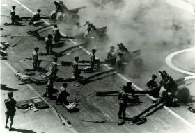 145 Battery, 29 Commando Regiment Royal Artillery firing from the flight deck of HMS Albion, Aden, 1967