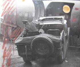 Loading of an Airborne jeep into an aircraft fuselage, c.1944