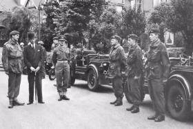 16 Coy's Austin Champs at the 1959 Grantham Carnival. To the right are Ptes Jacobs, Carter and Elsom.